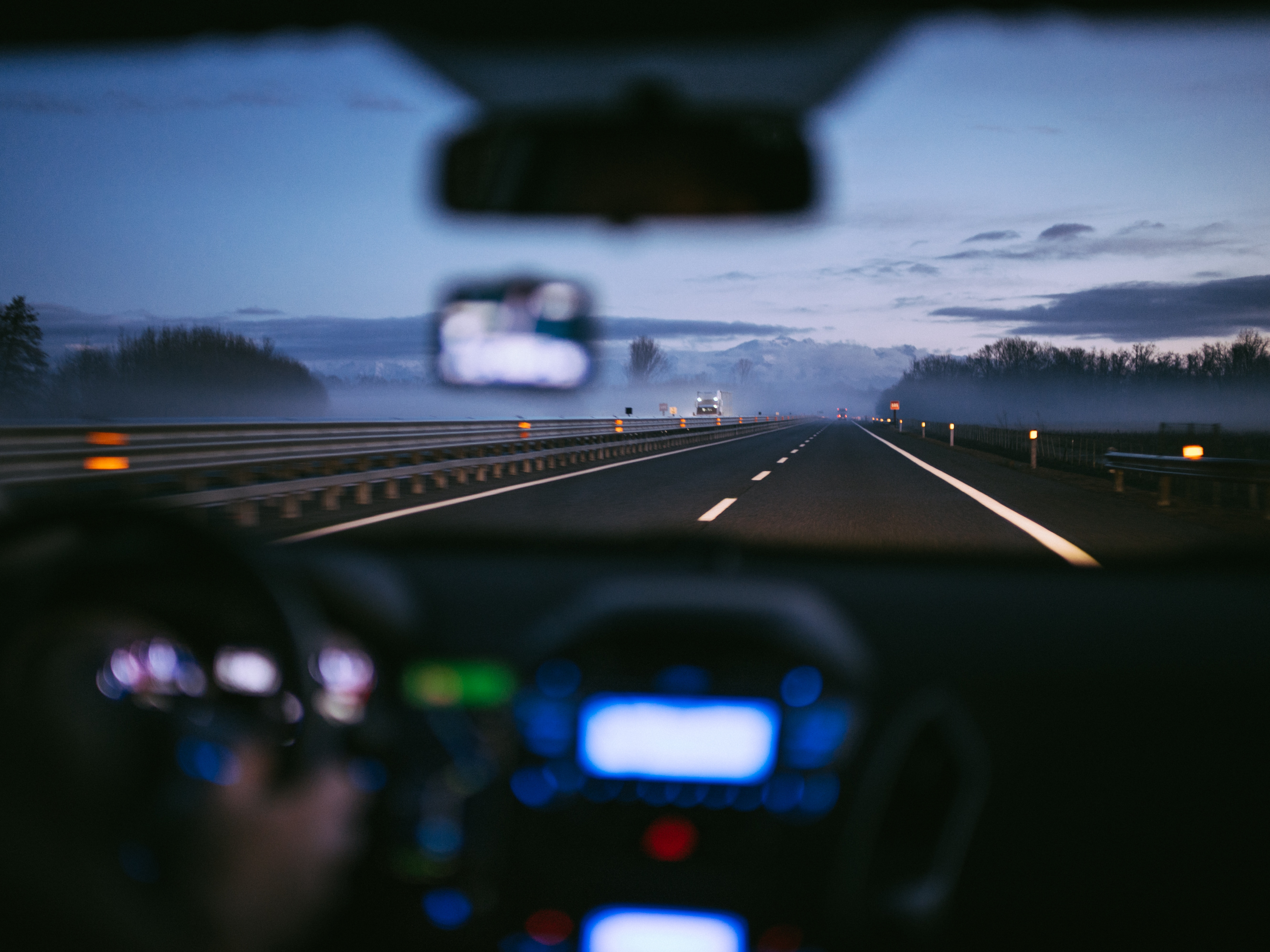 Driving at night looking through windshield