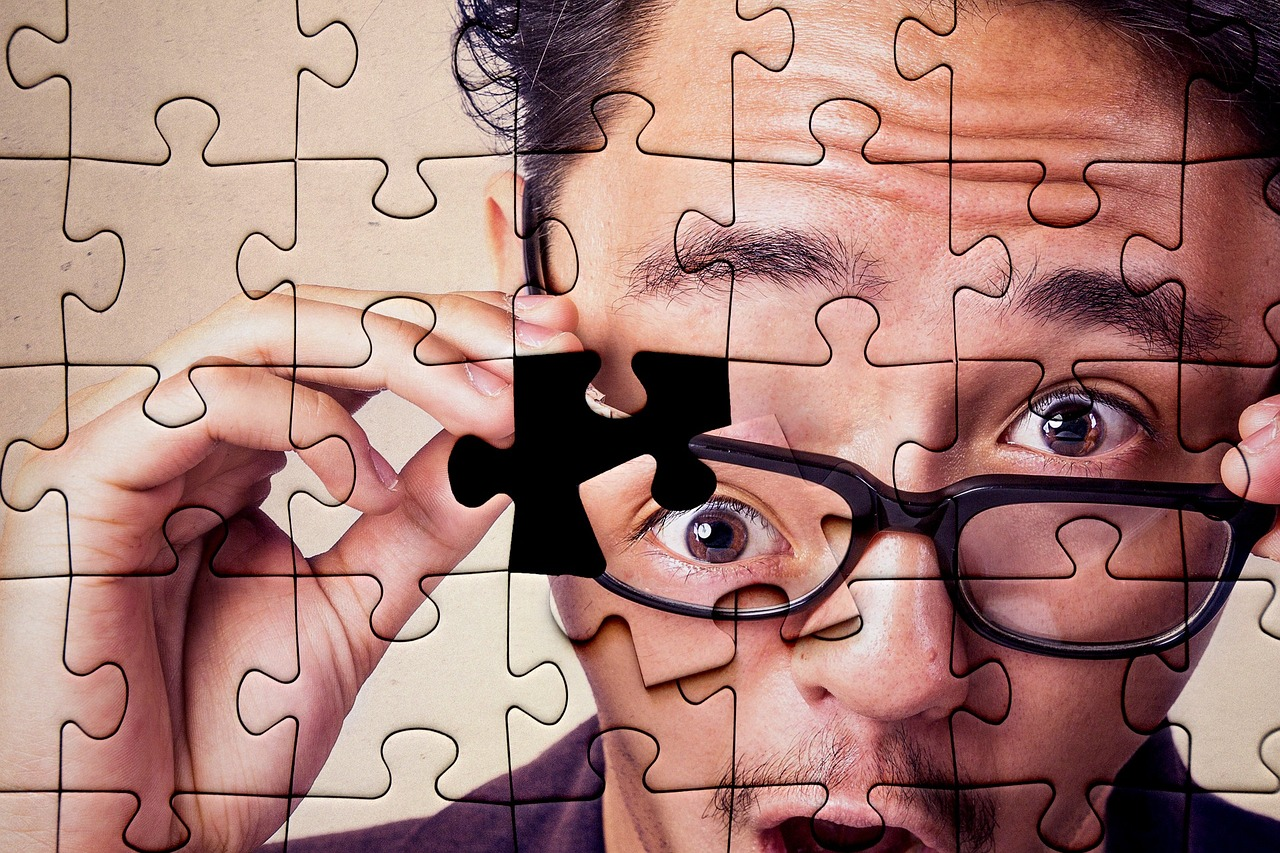Puzzle of Man's Face with a piece missing